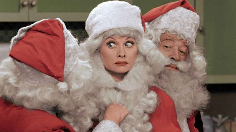 Lucille Ball, center, dressed as Santa Claus in