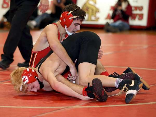 Sachem East's Doug Iadanza, left, wrestles with Pat-Med's