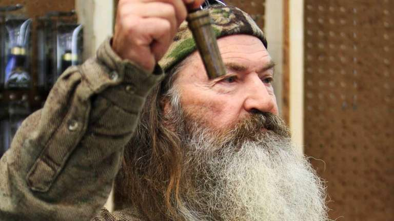 Phil Robertson, the Duck Commander, holding the 1