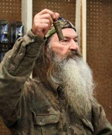 Phil Robertson, the Duck Commander, holding the 1 millionth duck call