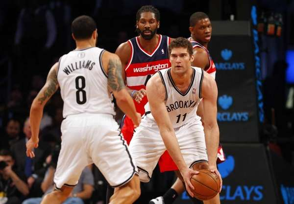 Brook Lopez of the Nets controls the ball