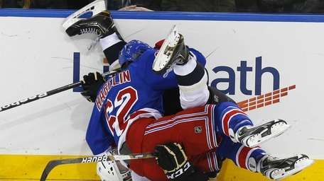 Olli Maatta of the Pittsburgh Penguins is upended