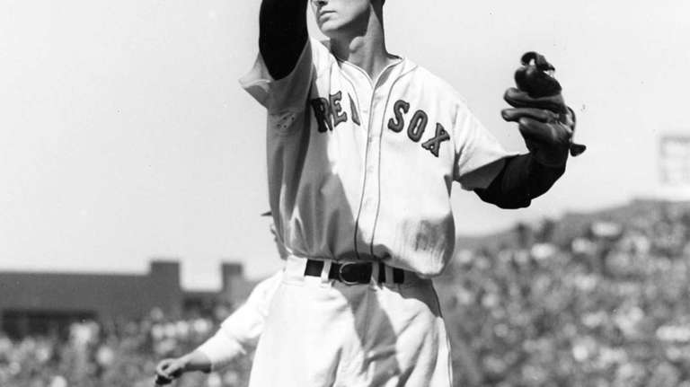Ted Williams limbering up, circa 1941. From