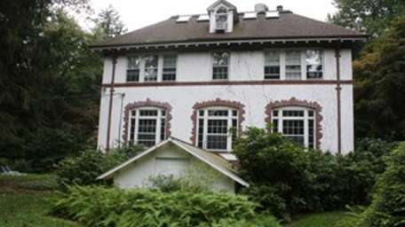 This stuccoed home in Laurel Hollow is listed