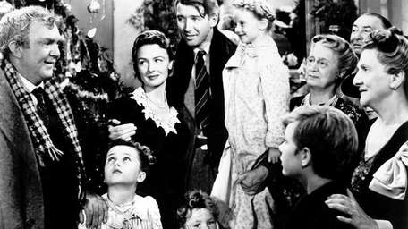 George Bailey (Jimmy Stewart, center) is reunited with