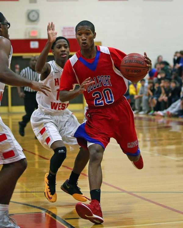 Bellport's Ronald Harris drives toward the net against