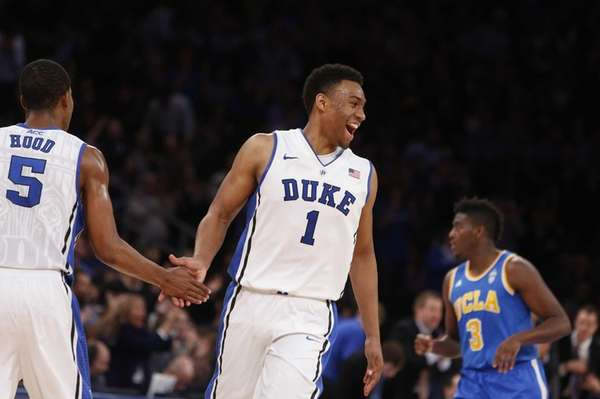 Duke's Jabari Parker celebrates with teammate Rodney Hood