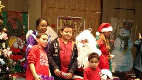 Santa entertains children during a holiday party at