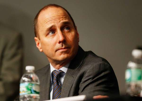 General Manager Brian Cashman looks on during Carlos