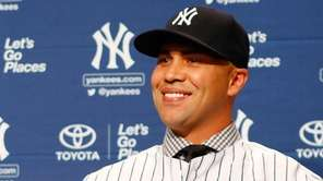 Outfielder Carlos Beltran speaks to the media during
