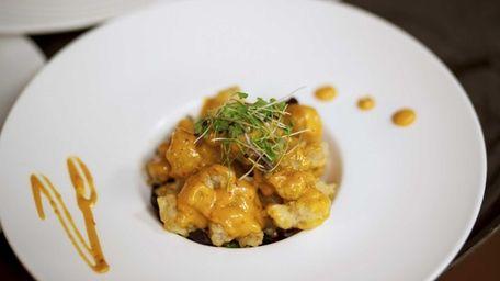 An appetizer of rock shrimp tempura with a
