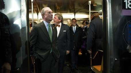 Mayor Michael Bloomberg peers from a train he