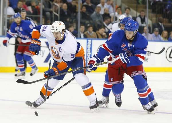 John Tavares of the Islanders tries to control