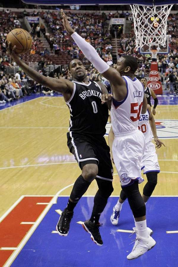 Nets' Andray Blatche goes up for a shot