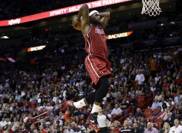 The Miami Heat's LeBron James goes up to