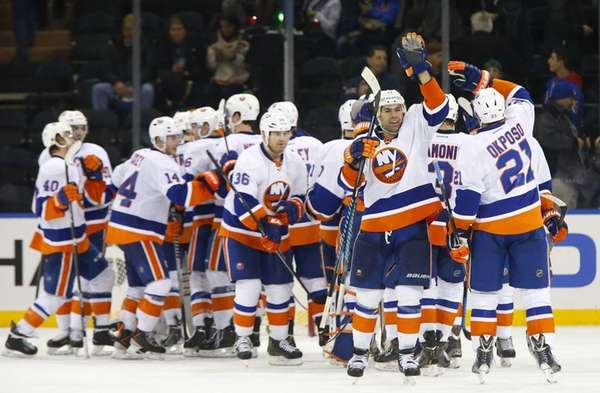 Brian Strait and Kyle Okposo of the Islanders