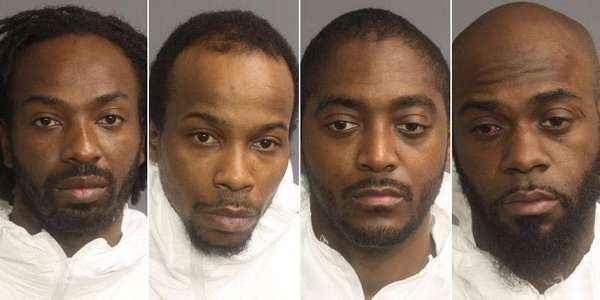 Karif Ford, far left, 31, of Newark; Kevin