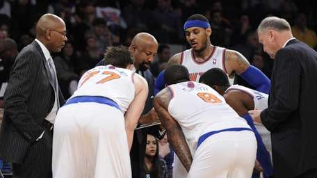 Knicks head coach Mike Woodson directs forward/center Andrea