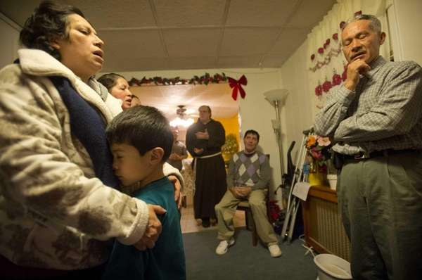 Martha Arriaza, left, holds her son Walter, 6,