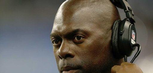Jets running backs coach Anthony Lynn looks on
