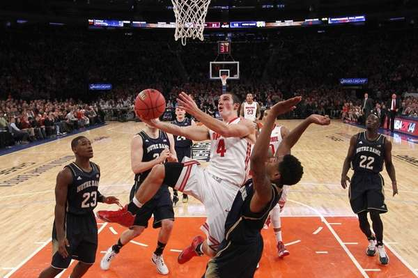 Ohio State's Aaron Craft draws a foul while