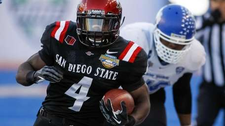 San Diego State running back Adam Muema runs
