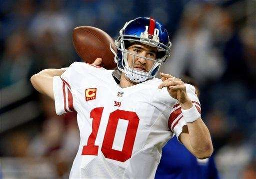 Eli Manning throws before a game against the