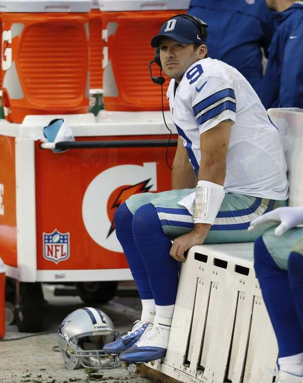 Dallas Cowboys quarterback Tony Romo sits on the