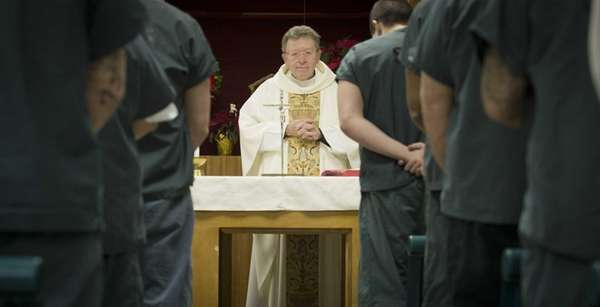 The Rev. Msgr. James McNamara conducts a service