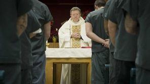 The Rev. Msgr. James McNamara conducts a service