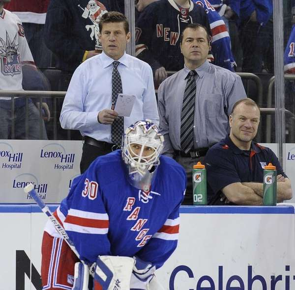 Ulf Samuelsson, left, and Alain Vigneault, right, observe