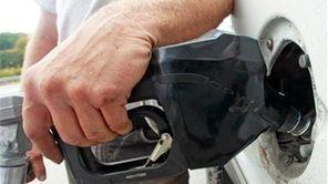 A customer fills up at a gas pump