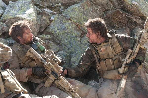 From left, Michael Murphy (Taylor Kitsch) and Marcus