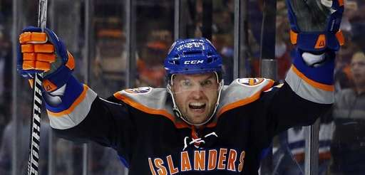 Thomas Vanek celebrates his third period goal against
