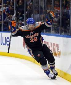 Thomas Vanek celebrates his third-period goal against the