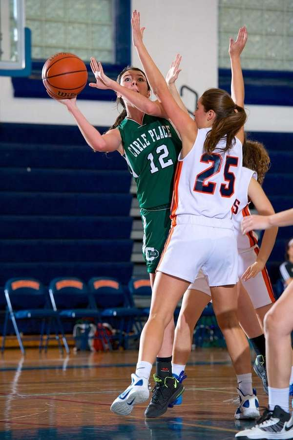 Carle Place forward Maria Hyland (12) attempts a
