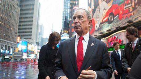 Mayor Michael Bloomberg cuts a ribbon at a