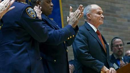 NYPD Police Commissioner Ray Kelly stands for a
