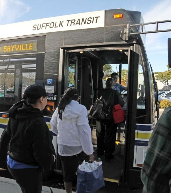 Passengers board a Suffolk County Transit Bus in