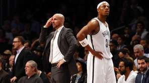 Jason Kidd and Paul Pierce look on after