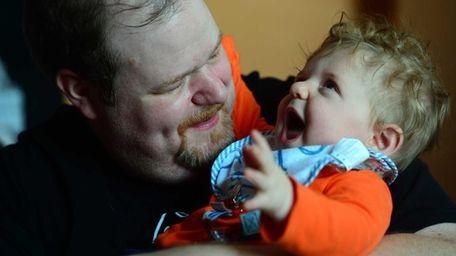 Matt Polashek with his 8 month-old son Gerald.