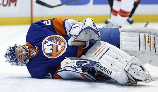Islanders goalie Evgeni Nabokov stops a Detroit Red