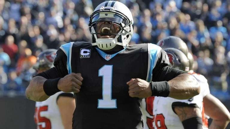 Cam Newton celebrates his touchdown pass against the