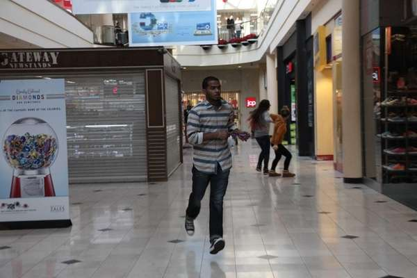 Shoppers flee the Roosevelt Field Mall in Garden