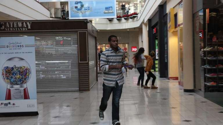 Shoppers flee the Roosevelt Field Mall in Garden