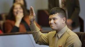 Lance Cpl. Christopher Mohedano-Hernandez participates in an adoption