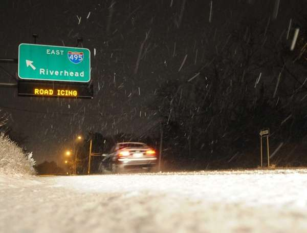 Scattered snowfall began on Long Island Tuesday, with
