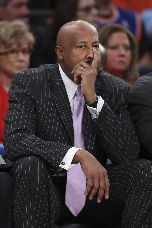 Knicks coach Mike Woodson reacts on the bench