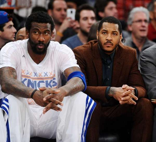 Amar'e Stoudemire and Carmelo Anthony sit on the