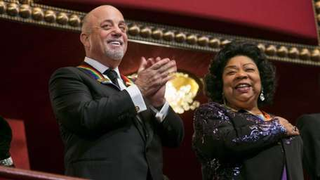 epa03983032 Kennedy Center Honorees Billy Joel, left, and